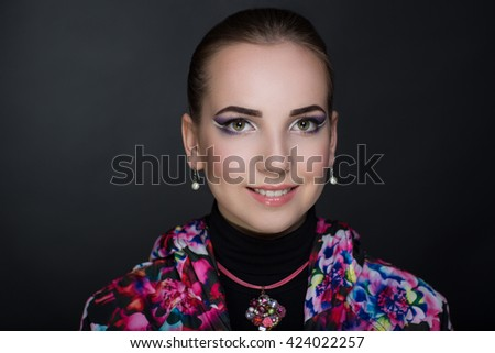 Stylish jacket with floral print pink white flowers. Big style accessory with natural expensive stones. Luxury Bright makeup shiny lipstick cosmetics.