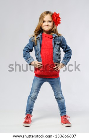 stylish little girl in the studio