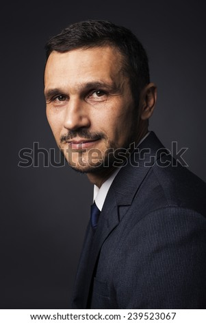 stylish man in a suit in a studio