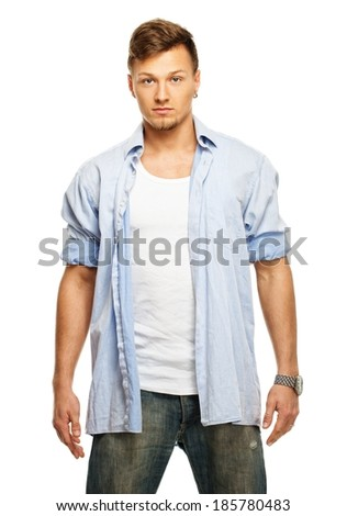 Stylish man in blue shirt and jeans with earring isolated on white