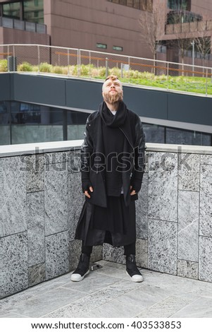 Stylish young bearded man posing in an urban context