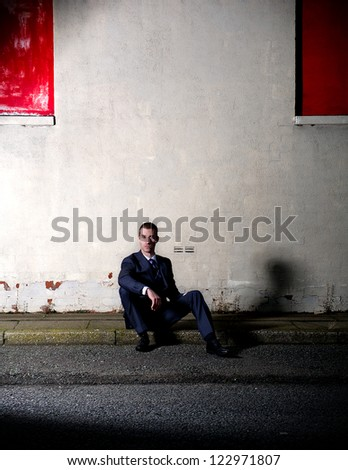 Stylish young gent relaxing outdoors