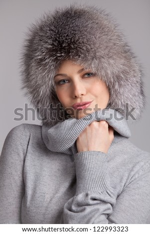Stylish young woman in winter fur hat