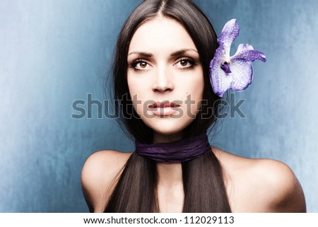 stylized woman portrait with orchid studio shot