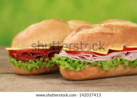 Sub Sandwiches with salami, ham, cheese, tomatoes and lettuce