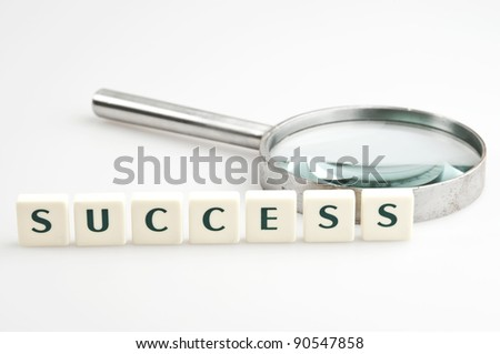 Success word and magnifying glass