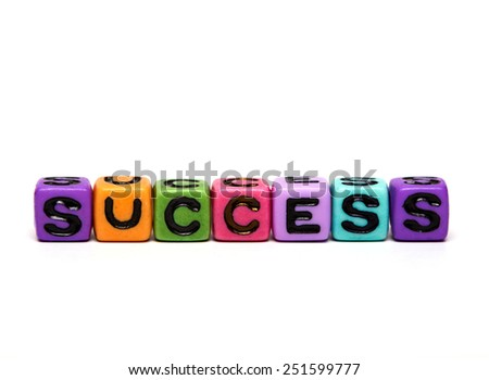 success - word made from multicolored child toy cubes with letters