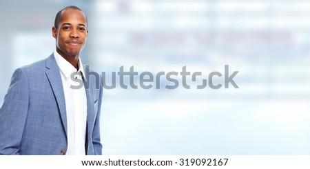 Successful African american businessman over grey background.