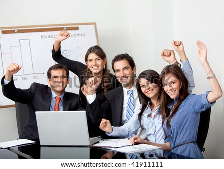 Successful business group with laptop at the office