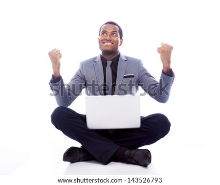 Successful business man with laptop and raised arms - isolated over a white background