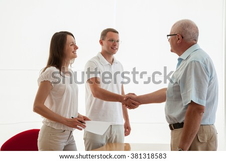 Successful business people shaking hands while making agreement
