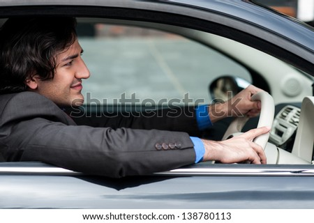 Successful businessman driving his car.