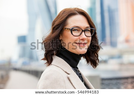 successful businesswoman in eyeglasses portrait, close up