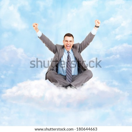 Successful excited business man happy smile hold fist gesture sitting on white cloud with clear blue sky, businessman with raised hands arms, wear suit and tie, concept of success