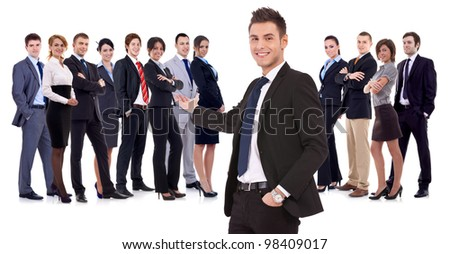 Successful happy business team being presented by a young leader, on white background. young business manwelcoming you to his business team