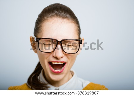 successful woman screaming in glasses isolated in the studio