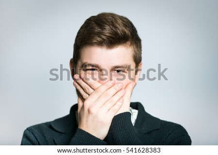 successful young businessman covers her mouth with her hands, stylish, manager closeup