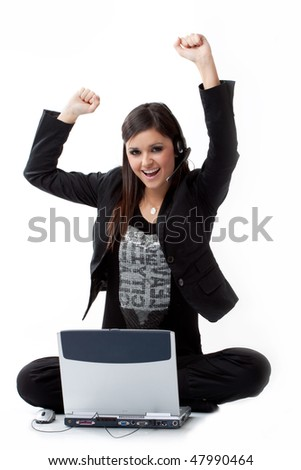 Successful young woman by the computer on the floor
