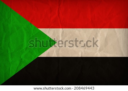 Sudan flag pattern on the paper texture ,retro vintage style