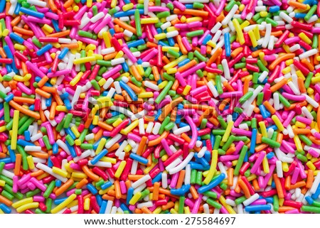 Sugar sprinkle dots, decoration for cake and bekery, a lot of sprinkles as a background