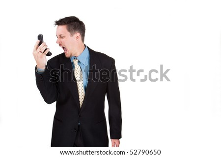 Suited man talking on a cell phone, isolated image