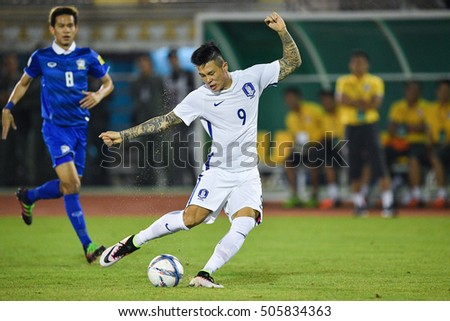 Suk Hyun-jun (white) of South Korea in action during The Friendy Match between Thailand and South Korea at Rajamangala Stadium on March 27, 2016 in Bangkok, Thailand