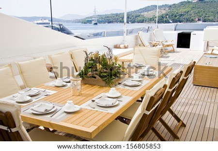 Summer day yacht deck with served table