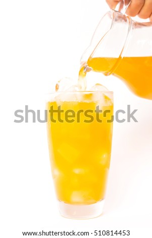 Summer drink: pouring fresh orange juice on ice in glass isolated on white background