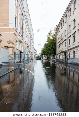 summer early morning on the old center in Moscow, asphalt with reflections under rain