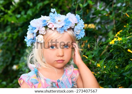 Summer girl - girl with a wreath of flowers