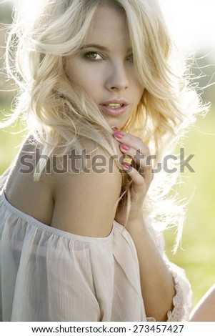 Summer girl portrait. Young attractive Caucasian woman outdoor.