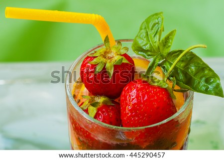 Summer strawberry beverage with fresh berries