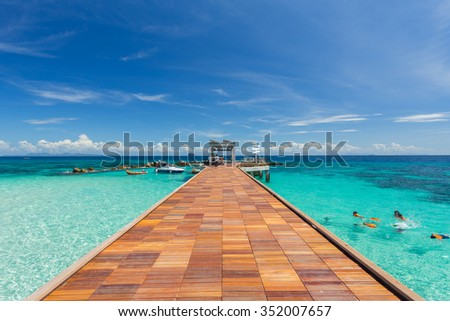 Summer, Travel, Vacation and Holiday concept - Wooden pier in Maiton Phuket Thailand