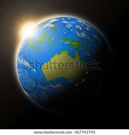 Sun over Australia on blue planet Earth isolated on black background. Highly detailed planet surface. Elements of this image furnished by NASA.