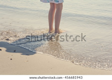 Sunbathing in the seaside - A girl's legs entering to the sea - Walking on the sand