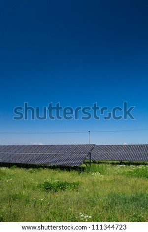 Sunlight as a resource of renewable energy: solar panels on a sunny day
