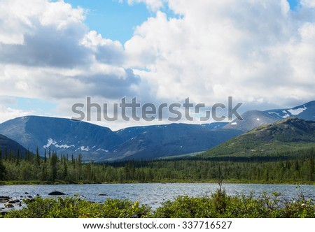 Sunny day at the lake in the mountains