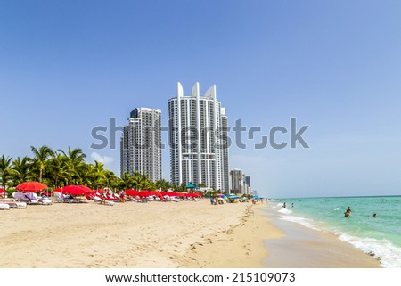 SUNNY ISLES BEACH, USA - AUG 17, 2014: people enjoy the Jade beach. Jade Beach and Ocean were completed in 2009 with a elevation of 549 feet located at 170th Street at Sunny Isles Beach, USA.