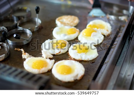 Sunny side up eggs on a grill in restaurant