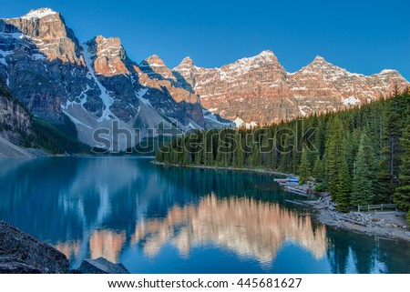 Sunrise at Moraine lake (at the Rockpile) with in the valley of ten peaks in Banff National Park (Canada, about 7 am in June )
