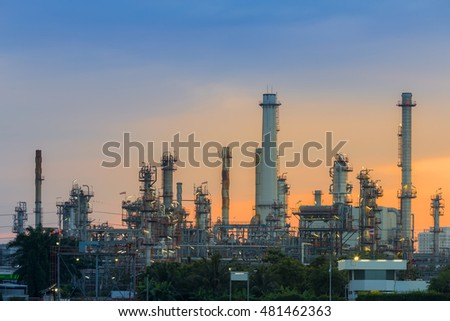 Sunrise background over petrol chemical refinery on cloudy day