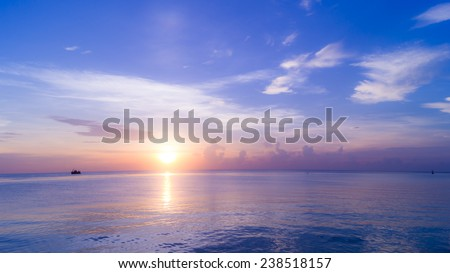 Sunrise from the sea with boat living scene