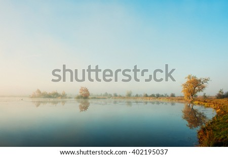 Sunrise on the lake in autumn and blue sky