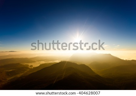 Sunrise on the mountain Adam's Peak ( also Sri Pada ). Sri Lanka. Beautiful landscape.