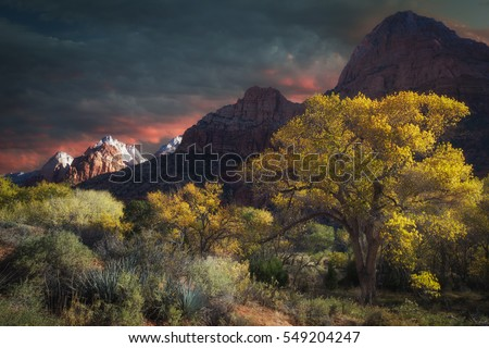 Sunrise over the beautiful red rock mountains in Zions national park in autumn Utah USA.