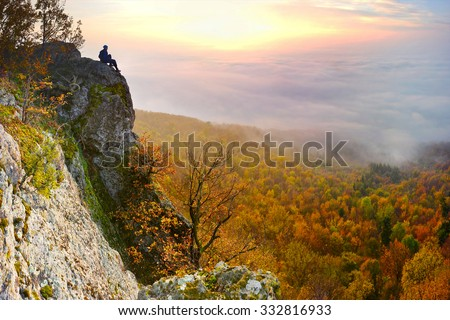 Tourist Stand On Top Big Mountains Stock Photo - This man hikes up the transylvanian mountains every morning to photograph sunrise