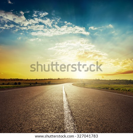 sunset and asphalt road
