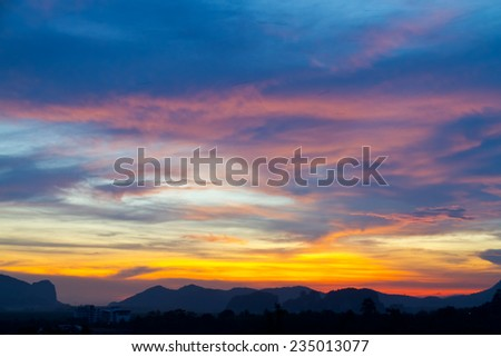 sunset behind the Mountains and twilight light in the sky