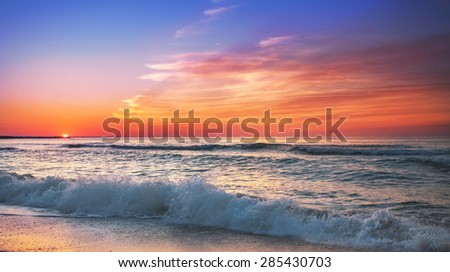 Sunset on the beach of caribbean sea.
