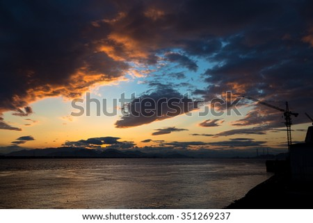 Sunset on the seashore with beautiful sky of clouds.